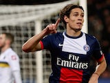 PSG's Edinson Cavani celebrates after scoring his team's third goal against Sochaux on December 7, 2013