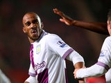 Aston Villa's Fabian Delph celebrates after scoring his team's third goal against Southampton during their Premier League match on December 4, 2013