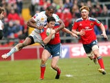Munster's Felix Jones is tackled by Perpignan's Watisoni Votu during their Heineken Cup match on December 8, 2013