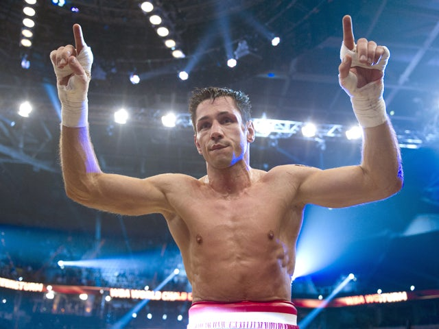 German World middleweight champion Felix Sturm celebrates after the fight against his English contender Martin Murray at the SAPArena in Mannheim, southern Germany on December 2, 2011