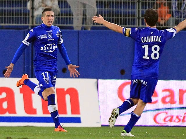 Bastia's Florian Raspentino celebrates after scoring the opening goal against Lyon during their Ligue 1 match on December 8, 2013