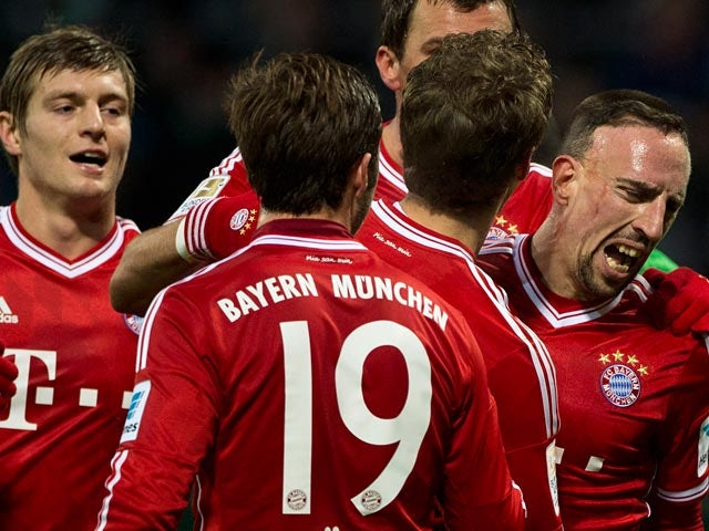 Bayern's Franck Ribery celebrates with teammates after scoring his team's third goal against Werder Bremen on December 7, 2013