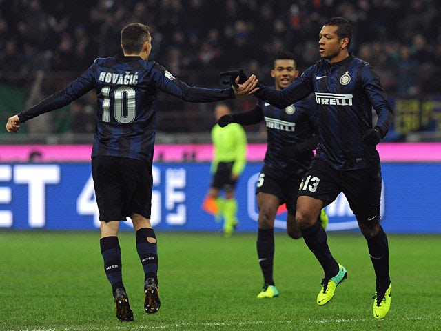 Inter's Fredy Guarin celebrates with teammates after scoring the opening goal against Trapani Calcio during their Coppa Italia match on December 4, 2013