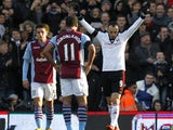 Fulham's Bulgarian striker Dimitar Berbatov celebrates scoring from the penalty spot during the English Premier League football match between Fulham and Aston Villa at Craven Cottage in London on December 8, 2013