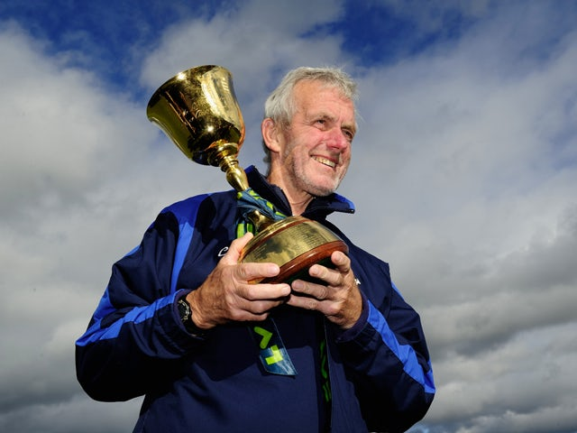 Durham coach Geoff Cook holds the trophy after winning the LV County Championship Division One title after day three of the LV County Championship Division One match between Durham and Nottinghamshire at The Riverside on September 19, 2013