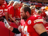 Kansas City Chiefs' Geoff Schwartz greets fans after the victory over Dallas Cowboys on September 15, 2013