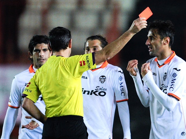 Jonas Goncalves of Valencia CF is shown a red card by the referee Jose Antonio Teixeira during the Copa del Rey round of 32 match between Gimnastic de Tarragona and Valencia at Nou Stadi on December 8, 2013