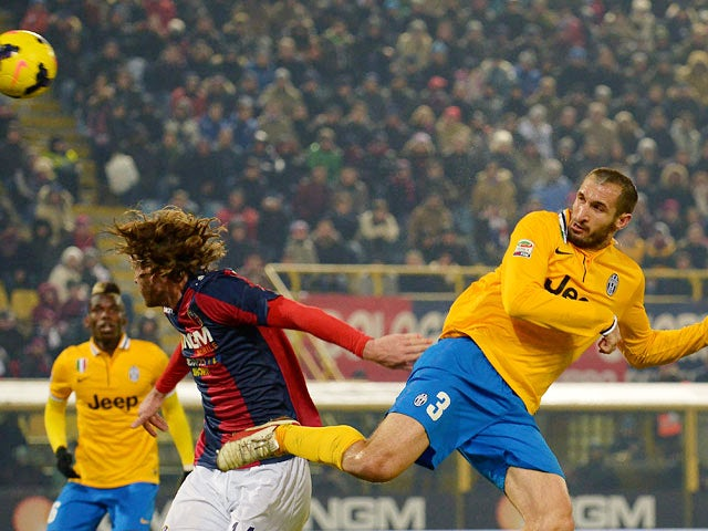 Juventus' Giorgio Chiellini scores his team's second goal against Bologna during their Serie A match on December 6, 2013