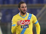 Napoli's Gonzalo Higuain celebrates after scoring the opening goal against Lazio during their Serie A match on December 2, 2013