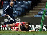 Edinburgh's Greig Tonks scores a try against Gloucester during their Heineken Cup match on December 8, 2013
