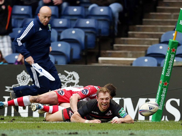 Edinburgh's Greig Tonks scores a try against Gloucester during their Heineken Cup match on December 8, 2013