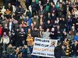 Hull City fans display a banner prior to the Barclays Premier League match between Hull City and Liverpool at KC Stadium on December 1, 2013