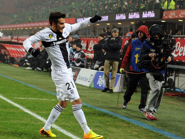 Nicola Sansone of Parma FC celebrates scoring the first goal during the Serie A match between FC Internazionale Milano and Parma FC at Stadio Giuseppe Meazza on December 8, 2013