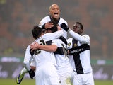 Marco Parolo of Parma FC celebrates scoring the second goal with teammates during the Serie A match between FC Internazionale Milano and Parma FC at Stadio Giuseppe Meazza on December 8, 2013