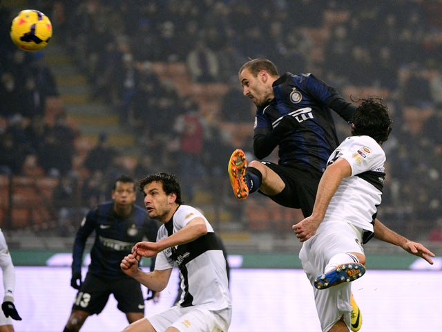 Inter Milan's Argentinian forward Rodrigo Sebastian Palacio scores during the Italian Serie A football match Inter Milan vs Parma on December 8, 2013