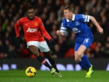 Everton's James McCarthy and Man United's Danny Welbeck in action during their Premier League match on December 4, 2013