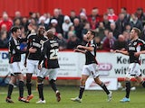 Bristol City's Jay Emmanuel-Thomas celebrates with teammates after scoring the opening goal against Tamworth during their FA Cup second round match on December 8, 2013