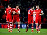 Southampton's Jay Rodriguez celebrates with teammates after scoring his team's opening goal against Aston Villa during their Premier League match on December 4, 2013