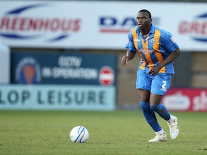Tyrone Barnett sends Shrewsbury Town top