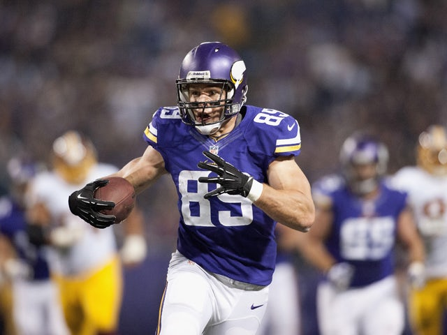 John Carlson #89 of the Minnesota Vikings carries the football during the game against the Washington Redskins on November 7, 2013