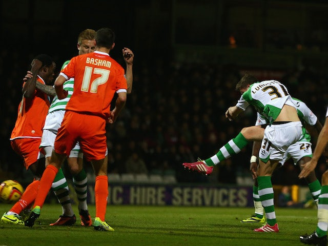 John Lundstram of Yeovil Town scores the opening goal during the Sky Bet Championship match between Yeovil Town and Blackpool at Huish Park on December 03, 2013