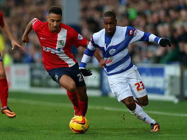 QPR's Junior Hoilett and Blackburn's Adam Henley in action during their Championship match on December 7, 2013