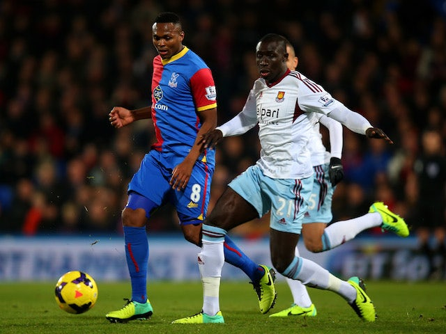 Kagisho Dikgacoi of Crystal Palace and Mohamed Diame of West Ham compete for the ball during the Barclays Premier League match on December 3, 2013