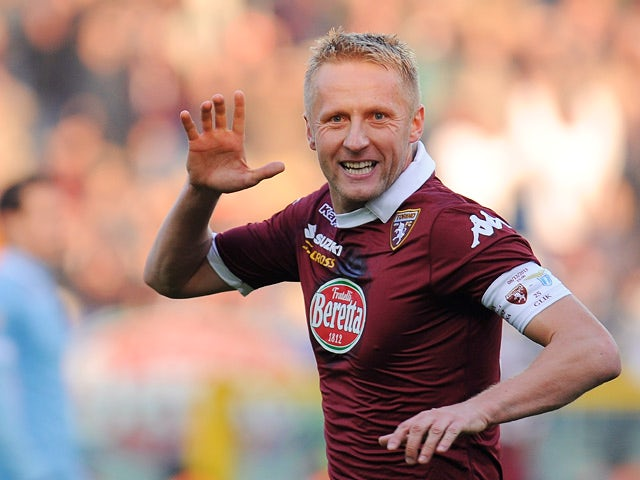 Torino's Kamil Glik celebrates after scoring the opening goal against Lazio during their Serie A match on December 8, 2013