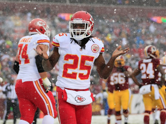 Running back Jamaal Charles #25 of the Kansas City Chiefs celebrates after rushing for a first quarter touchdown against the Washington Redskins at FedExField on December 8, 2013