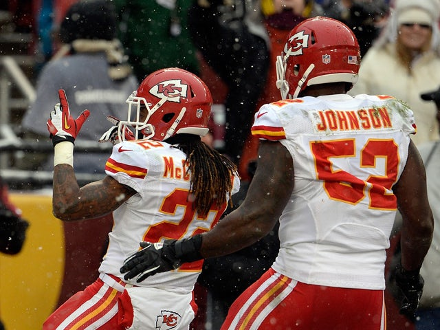 Dexter McCluster #22 of the Kansas City Chiefs celebrates after returning a punt for a touchdown in the second quarter during an NFL game against the Washington Redskins at FedExField on December 8, 2013