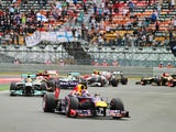 Sebastian Vettel of Germany and Infiniti Red Bull Racing leads the field on lap one of the Korean Formula One Grand Prix at Korea International Circuit on October 6, 2013