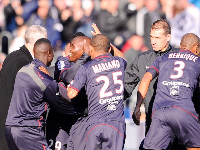 Bordeaux's Landry Nguemo celebrates with teammates after scoring the opening goal against Lille during their Ligue 1 match on December 8, 2013
