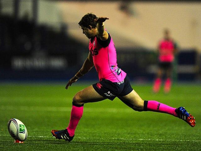 Cardiff Blues' Leigh Halfpenny kicks a goal against Glasgow Warriors during their Heineken Cup match on December 6, 2013