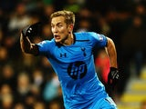 Tottenham's Lewis Holtby celebrates after scoring his team's second goal against Fulham during their Premier League match on December 4, 2013