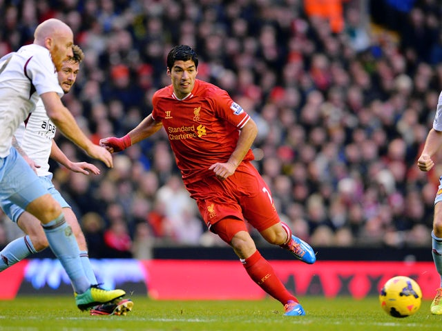 Liverpool's Uruguayan striker Luis Suarez runs with the ball during the English Premier League football match between Liverpool and West Ham United at Anfield in Liverpool on December 7, 2013