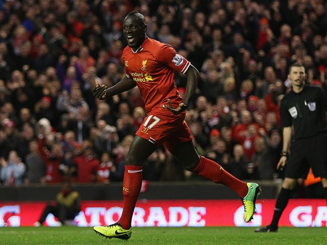 Mamadou Sakho of Liverpool celebrates scoring his team's second goal during the Barclays Premier League match between Liverpool and West Ham United at Anfield on December 7, 2013