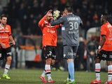 Rennes' players celebrate their victory at the end of the French L1 football match Lorient vs Rennes on December 7, 2013