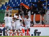 Lorient's players celebrate after scoring the opening goal against Montpellier during their Ligue 1 match on December 4, 2013