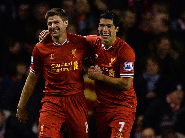 Liverpool's Luis Suarez celebrates with teammate Steven Gerrard after scoring his team's second goal against Norwich during their Premier League match on December 4, 2013