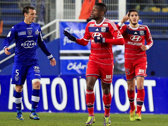 Lyon's French forward Yassine Benzia reacts after scoring during the French L1 football match Bastia against Lyon in the Armand Cesari stadium in Bastia, Corsica, on December 8 , 2013