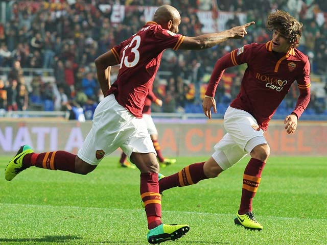 Roma's Maicon celebrates with teammate Dodo after scoring the opening goal against Fiorentina during their Serie A match on December 8, 2013