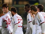 Milan's Mario Balotelli celebrates with teammates after scoring the opening goal against Livorno during their Serie A match on December 7, 2013