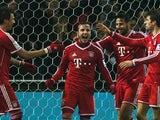 Bayern's Mario Gotze celebrates with teammates after scoring his team's seventh goal against Werder Bremen during their Bundesliga match on December 7, 2013