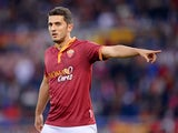 AS Roma's Brazilian midfielder Marquinho gestures during the Italian Serie A football match between AS Roma and Sassuolo at Rome's Olympic stadium on November 10, 2013