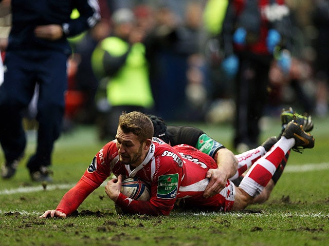 Gloucester's Martyn Thomas scores a try against Edinburgh during their Heineken Cup match on December 8, 2013