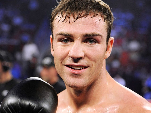 Matthew Macklin celebrates victory after defeating Joachim Alcine in their middleweight fight in Las Vegas on September 15, 2012