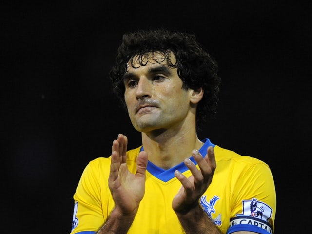 Crystal Palace captain Mile Jedinak applauds the fans after the Barclays Premier League match between West Bromwich Albion and Crystal Palace at The Hawthorns on November 2, 2013