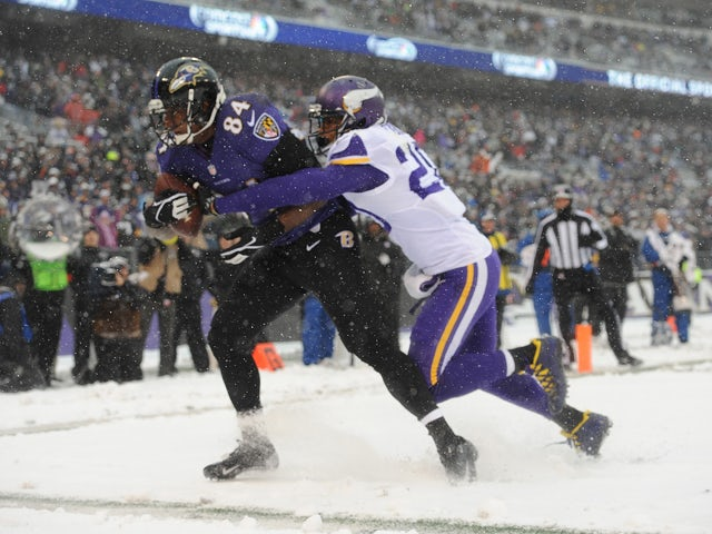 Tight end Ed Dickson #84 of the Baltimore Ravens beats cornerback Chris Cook #20 of the Minnesota Vikings for the game's first touchdown at M&T Bank Stadium on December 8, 2013