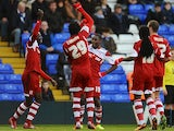 Middlesbrough's Mustapha Carayol celebrates with teammates after scoring the opening goal against Birmingham during their Championship match on December 7, 2013