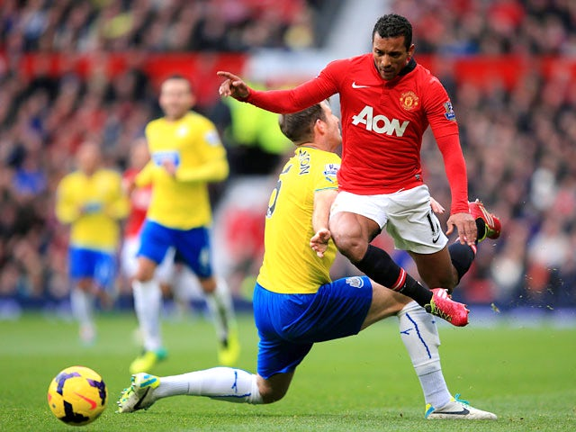 Man United's Nani and Newcastle's Mike Williamson in action during their Premier League match on December 7, 2013